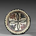 Coupe samanide à décor noir et rouge. asie centrale, probablement samarcande, xe siècle