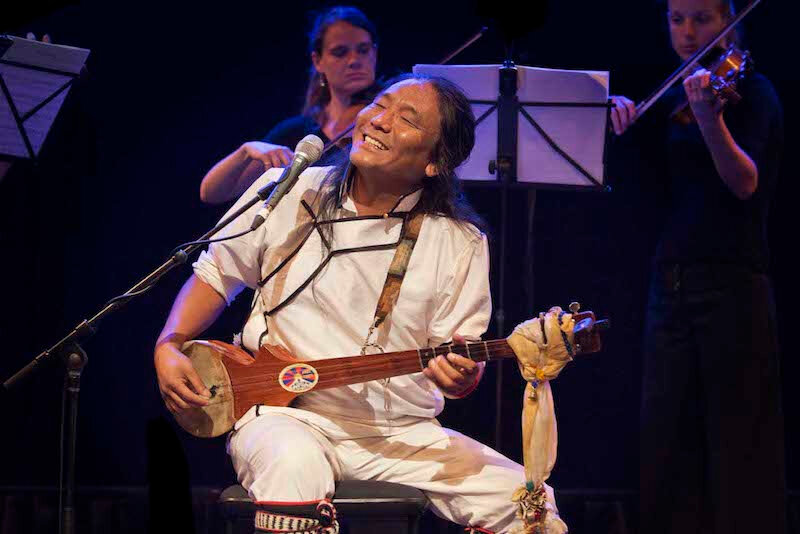 Tibetan-musician-Tenzin-Choegyal-performing-in-a-concert-Phayul-photo