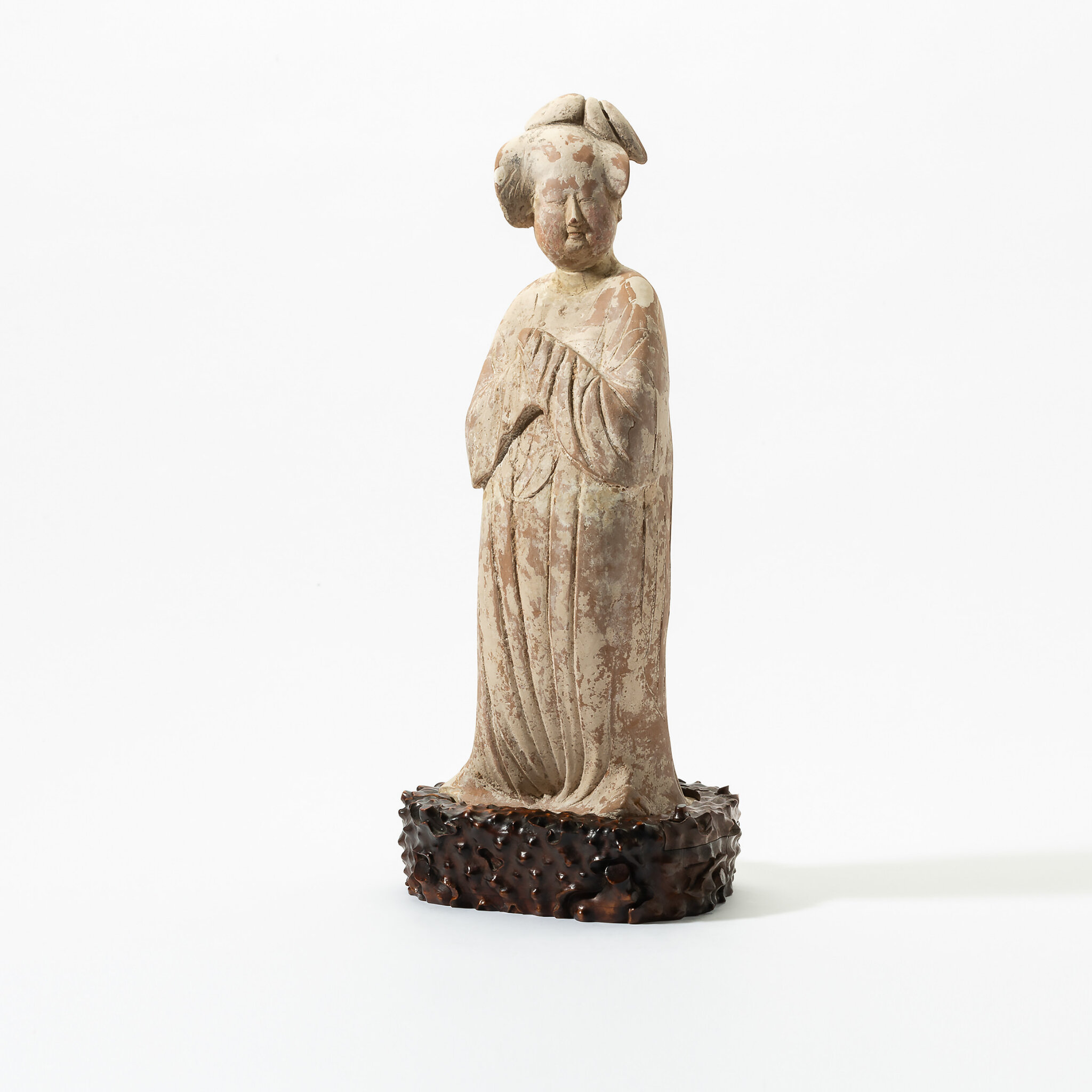 A Chinese pottery figure of a fat lady, Tang dynasty (618-907)