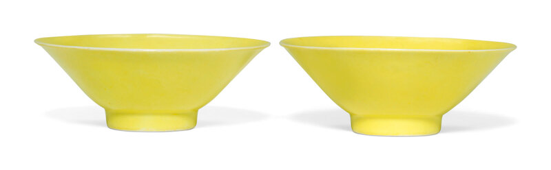 A pair of lemon-yellow-enamelled flared cups, Qianlong six-character marks in underglaze blue and of the period (1736-1795)