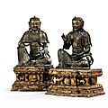 An important and very rare pair of parcel-gilt bronze figures of bodhisattva, 14th century