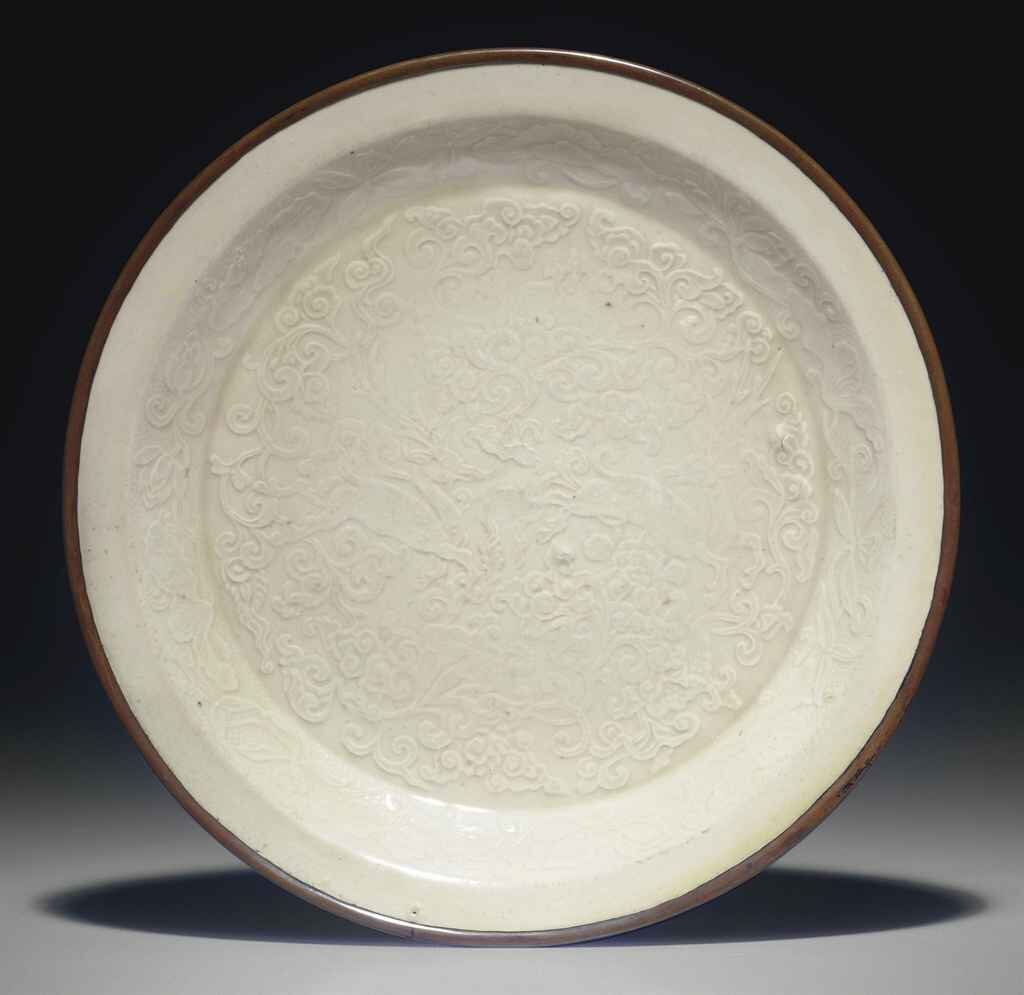 A molded Dingyao dish, Jin dynasty (1115-1234)