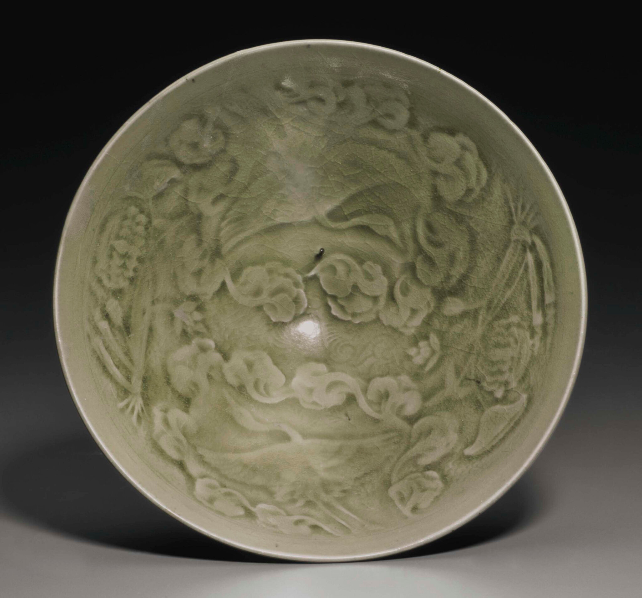 A rare large Yaozhou celadon molded conical bowl, China, Northern Song-Jin Dynasty, 11th-12th century