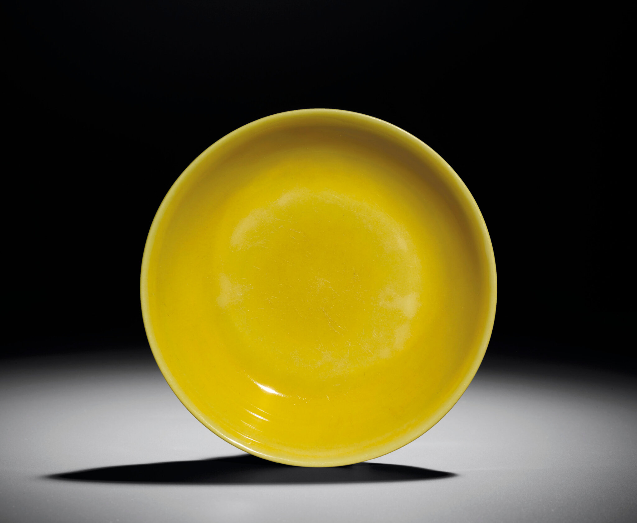 A yellow-enamelled dish, Zhengde four-character mark within double-circles and of the period (1506-1521)