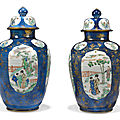 A pair of rare chinese powder-blue-ground famille verte vases and covers, kangxi period (1662-1722)