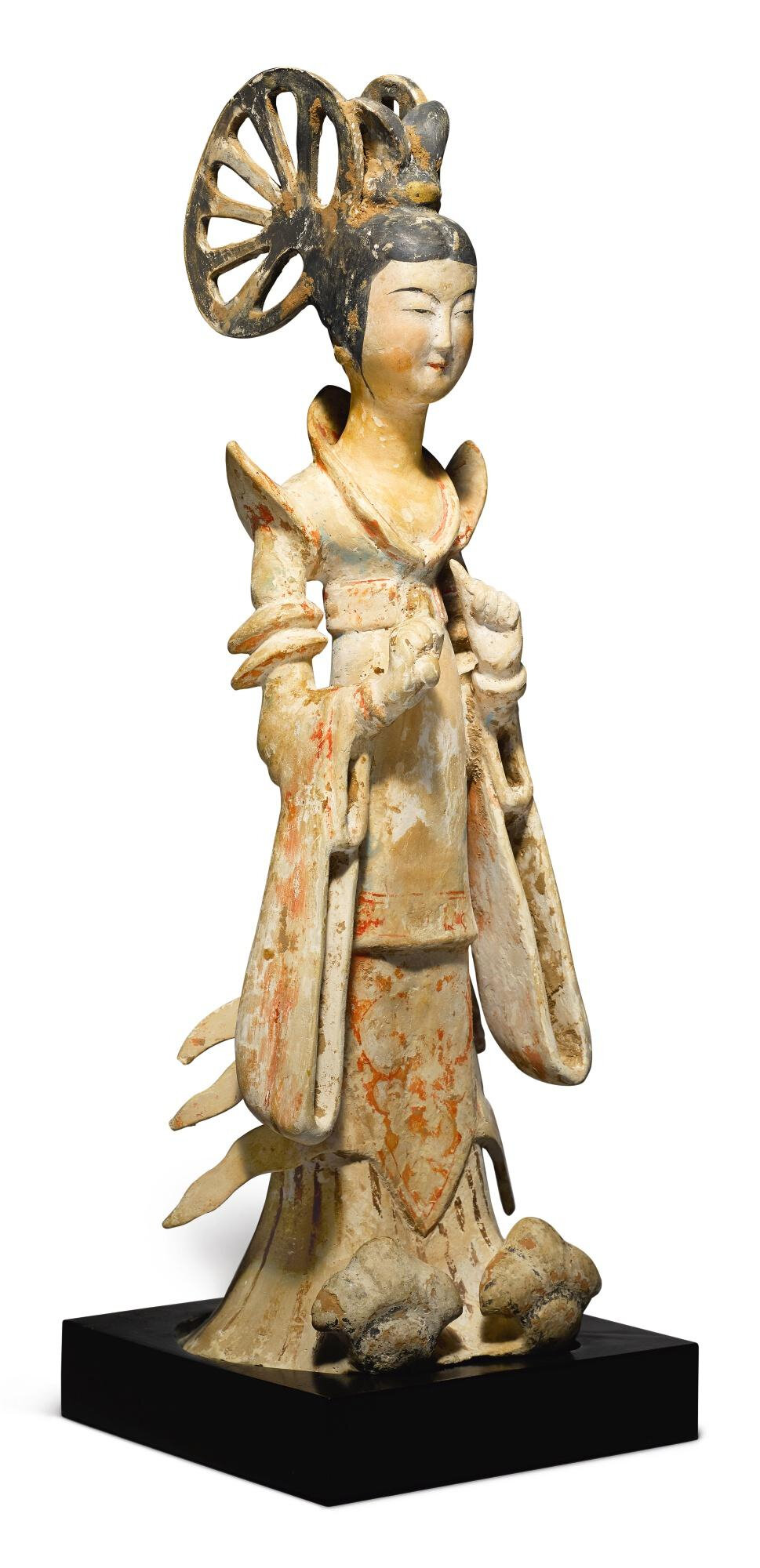 A painted pottery standing figure of a court lady, Tang dynasty, 7th - early 8th century