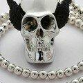 Les Bijoux de Sophie, Sautoir argent avec tête de mort ailée